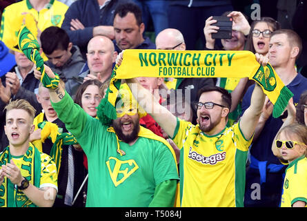 Norwich City fans in fine voice during the Sky Bet Championship match at Carrow Road, Norwich. - Stock Image
