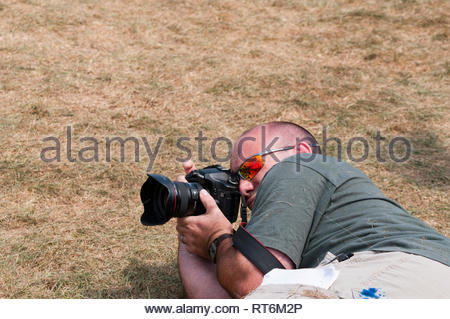 Professional photographer takes some low angle photos at Virginia Scottish Games in 2009. - Stock Image