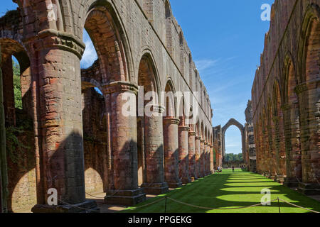 Fountains Abbey, North Yorkshire, a UNESCO World Heritage Site – well-preserved ruins of a Cistercian Monastery - Stock Image