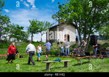 Mountain village saints day festival wth band and people dancing, Soubras, Piemonte, Italy - Stock Image