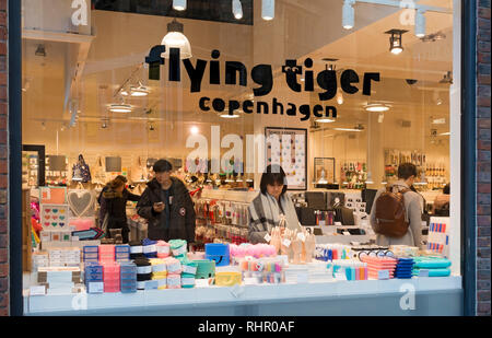 People shopping inside Flying Tiger Copenhagen store York North Yorkshire England UK United Kingdom GB Great Britain - Stock Image