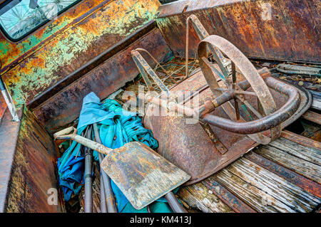 Old rusted fifties truck and contents seen on Route 66, Arizona, USA - Stock Image