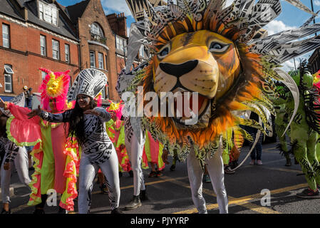 London, UK. 9th September 2018. The Hackney Carnival. The streets were full of stalls, floats, performers and spectators enjoying the carnival spirit. This years Carnival, the biggest yet, had 28 carnival groups and 1000 performers taking part.  The carnivals theme was Iconic Hackney. Organised by Hackney Council, tfl, Shoreditch Town Hall, Global Carnivalz and Hackney Walk. Credit: Stephen Bell/Alamy Live News. - Stock Image