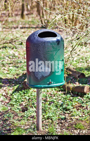 Burned green dustbin, outside - Stock Image