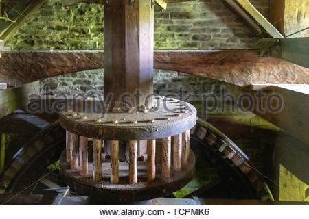 Wood mechanism with sprocket wheels inside of the Roblin's Mill located in the Black Creek Pioneer Village. The famous place is a tourist attraction w - Stock Image