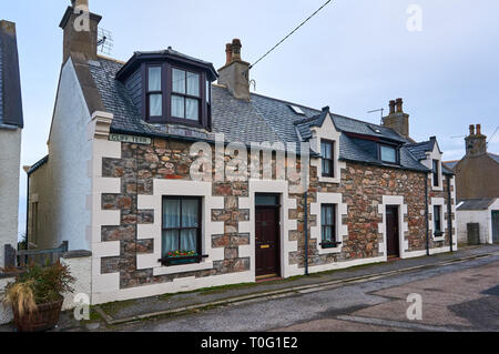 A typical house in a coastal fishing village of Portknockie in northern Scotland, UK - Stock Image