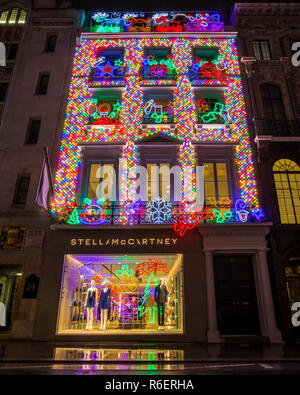 London, UK - December 4th 2018: a view of the exterior of the Stella McCartney store on Old Bond Street during Christmas-time, on 4th December 2018. - Stock Image