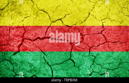 Autonomous Administration of North and East Syria, Rojava flag on dry earth ground texture background - Stock Image