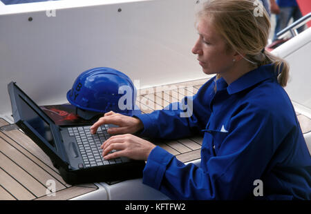 female marine engineer on laptop - Stock Image