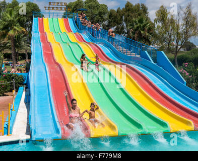 People on a waterslide in Aquamar Water Park, Platja d'en Bossa, Ibiza Spain - Stock Image