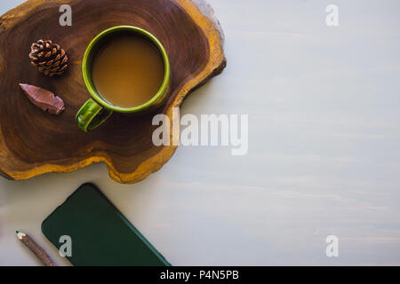 Table Top with Wood Slice, Coffee, Pencil, Phone and Space for Copy - Stock Image