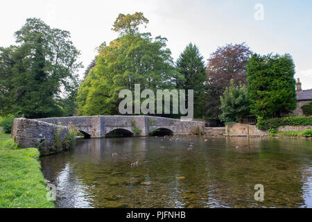 The picturesque scenes at the Sheepwash Bridge on the River Wye at Ashford In The Water, Peak District National Park, Derbyshire - Stock Image