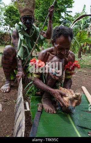 Demonstration of making fire, Tufi, Oro Province, Papua New Guinea - Stock Image