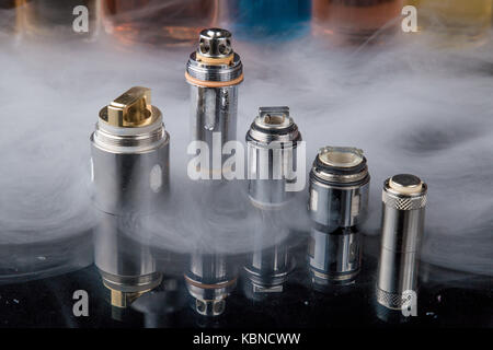 Electronic cigarette Clearomizer coils in smoke cloud - Stock Image
