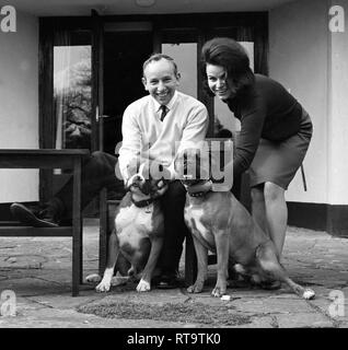 John Surtees with wife and pet Boxer dogs 1966 - Stock Image