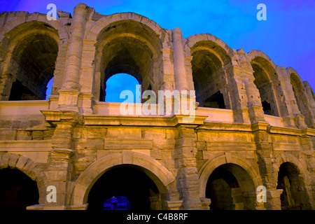 Arles; Bouches du Rhone, France; Detail of arches of the historical Amphitheatre in evening - Stock Image