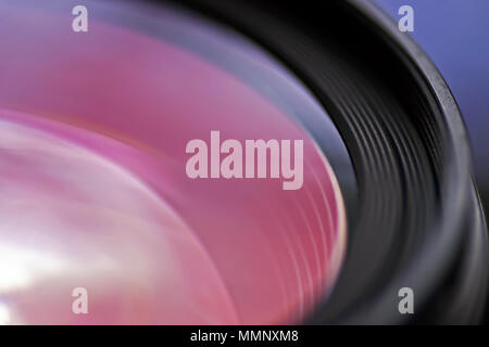 The distinctive anti-reflective coating of a camera lens. - Stock Image