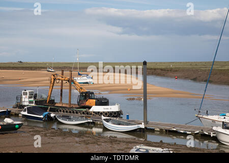 Grey storm clouds over Wells-Next-The-Sea as people enjoy a day out on Father's Day - Stock Image