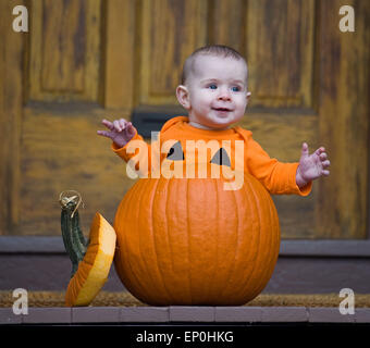 Baby boy in a pumpkin - Stock Image