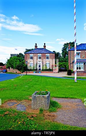 Period Properties and Maypole, Aldborough, North Yorkshire, England - Stock Image
