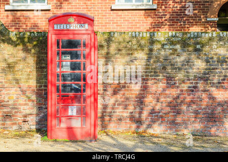 Traditional red telephone box on street of Hampstead Heath in London - Stock Image