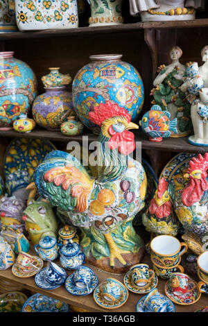 Display of traditional ceramics in ancient artisan ceramic shop in the city of Taormina, East Sicily, Italy - Stock Image