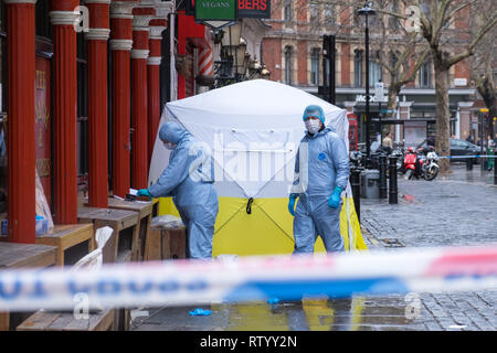Soho, London, UK - March 3, 2019: Forensic officers at the crime scene outside in Romilly Street in Soho. Credit: michelmond/Alamy Live News - Stock Image