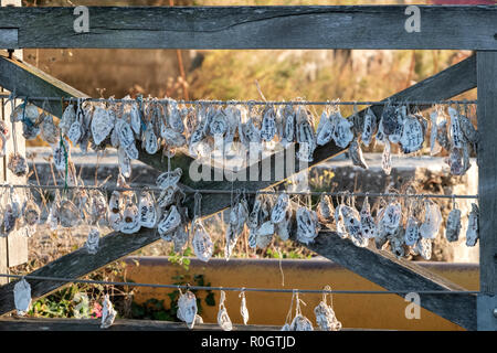 EUROPE, France, Île d'Oléron, Château-d'Oléron, Touristic tradition of attaching oyster shell to a bridge. - Stock Image