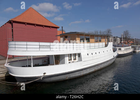 Houseboats Iggesund and Viking in Proviantmagasingraven canal, at Holmen, Copenhagen inner harbour, denmark. - Stock Image