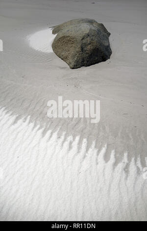 Natural patterns caused by freshwater seeping across beach, Bay of Fires, near St Helens, Tasmania, Australia - Stock Image