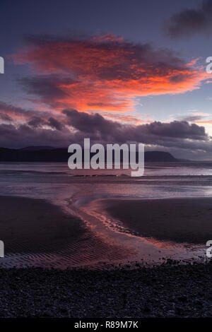 Sunlit clouds at sunset over the North Wales coast at Llandudno est Shore - Stock Image