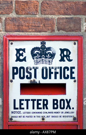 old historic rural village post office at Woburn old post box Save our post office - Stock Image