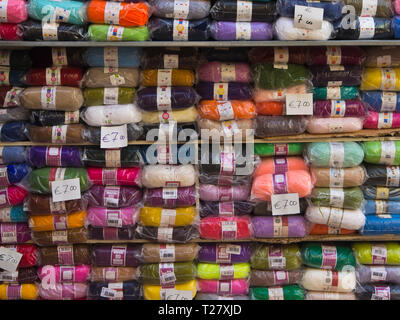 Colourful stacks of knitting yarn with price tags from a market stall in the Turkish Cypriot part of Nicosia, Cyprus - Stock Image