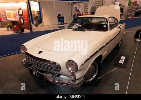 The original, fully restored, 1961 Volvo P1800  which was used  by Roger Moore in the TV series of 'The Saint', at the 2018 London Classic Car Show - Stock Image