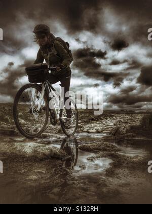 Extreme cycling tour on Hardangervidda mountain plateau, Norway - Stock Image
