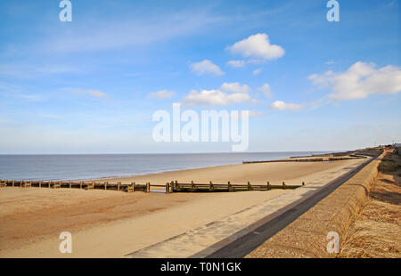A view of the beach on an early spring day on the North Norfolk coast at Bacton-on-Sea, Norfolk, England, United Kingdom, Europe. - Stock Image