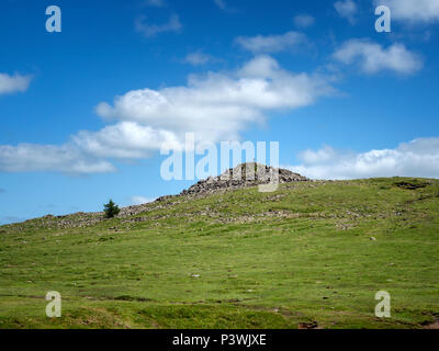 Lone figure on top of Sharpitor in Datmoor National Park, Devon, England - Stock Image