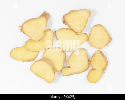 sliced ginger root on a white background - Stock Image