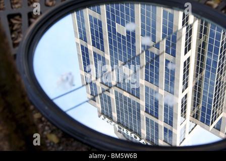 Wachovia bank building seen through a cracked mirror - Stock Image
