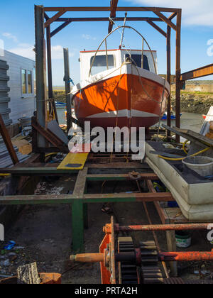 A small fishing boat the Vicky-Leigh, hauled above water on a slipway for refurbishment in Paddys Hole Harbour, Teesmouth, Redcar Cleveland UK - Stock Image