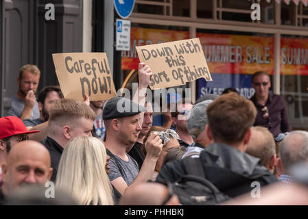 Worcester, United Kingdom. 1 September 2018. The English Defence League (EDL) held a national demonstration in the West Midlands town of Worcester, approximately 200 people attended. A counter-protest was held a short distance away with approximately 500 people. PICTURED: Counter-protesters hold up a sign in Worcester town centre. Credit: Peter Manning/Alamy Live News - Stock Image