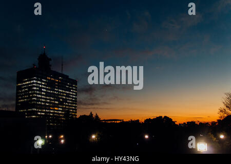 Illuminated Cityscape Against Sky At Dusk - Stock Image