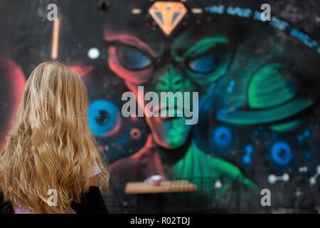 Girl with blonde hairs from behind - Stock Image