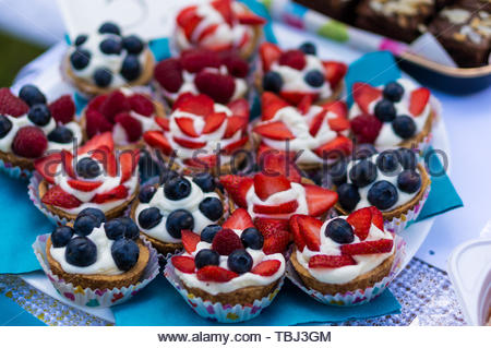 Fresh baked home made cakes topped with strawberry - Stock Image