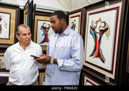 Fort Lauderdale Ft. Florida Las Olas Boulevard Las Olas Art Fair festival artist Aaron Reed Black man men paintings shopping tal - Stock Image