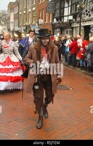 Rochester, Kent, UK. 1st December 2018: A man dressed as a character from the Dickensian era participates in the main parade on Rochester High Street. in Hundreds of people attended the Dickensian Festival in Rochester on 1 December 2018. The festival's main parade has participants in Victorian period costume from the Dickensian age. The town and area was the setting of many of Charles Dickens novels and is the setting to two annual festivals in his honor. Photos: David Mbiyu/ Alamy Live News - Stock Image