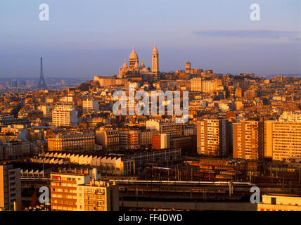 Sacre-Coeur and Eiffel Tower above Paris skyline at sunrise - Stock Image