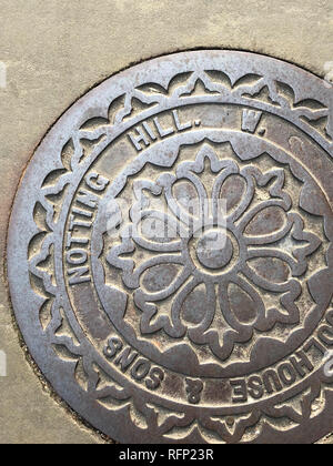 Drain cover in Notting Hill, London, England. - Stock Image