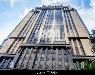 Granite, bronze and glass edifice of the Art Deco Style Gotham Building, or Parkview Square, in Bras Basah Singapore. - Stock Image