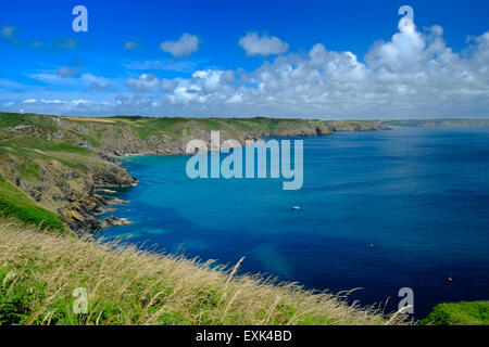 Clear blue water at Church Cove, Lizard, Cornwall, UK, from South West Coastal Path - Stock Image